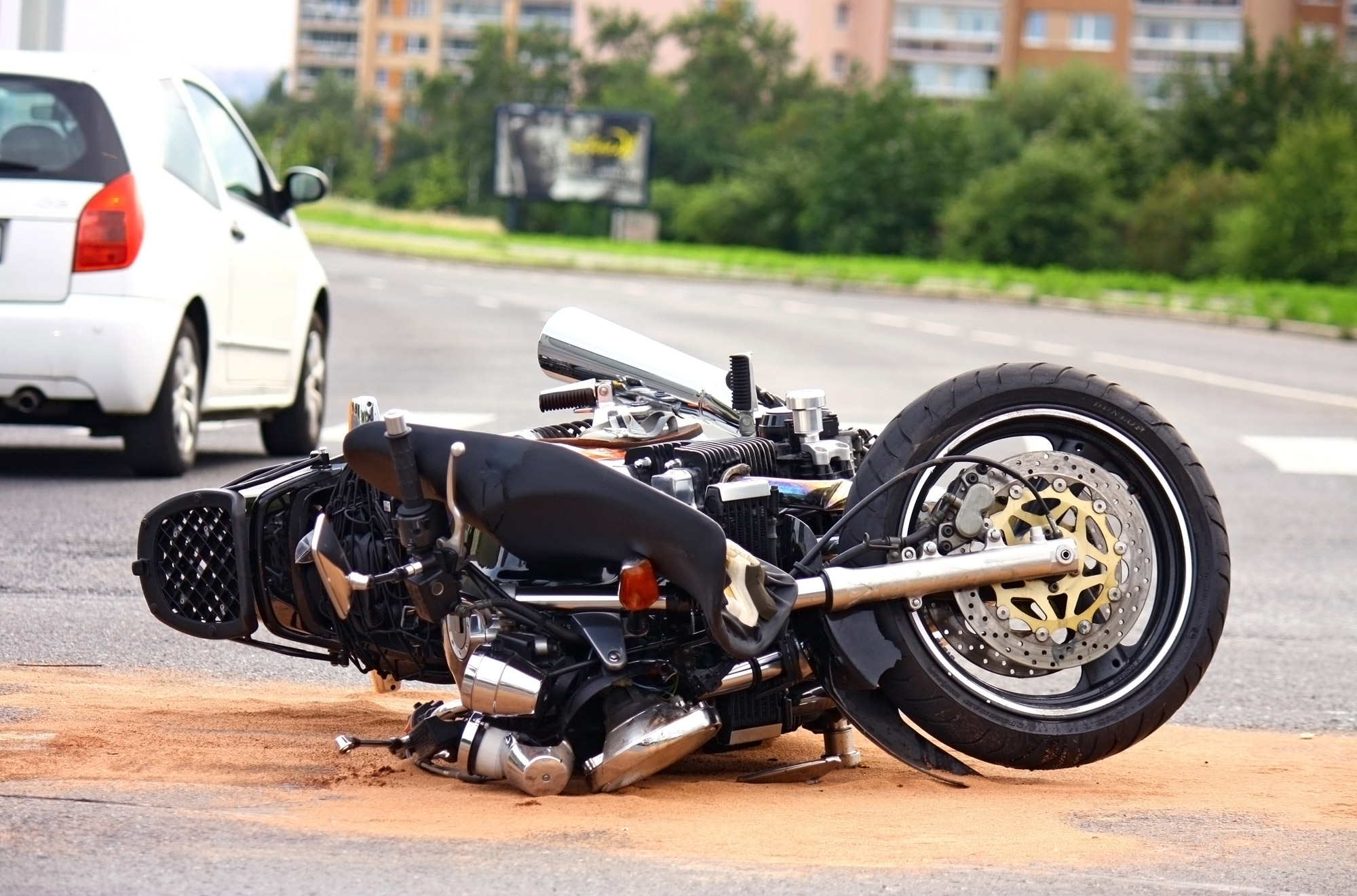 motorcycle on ground after accident with car