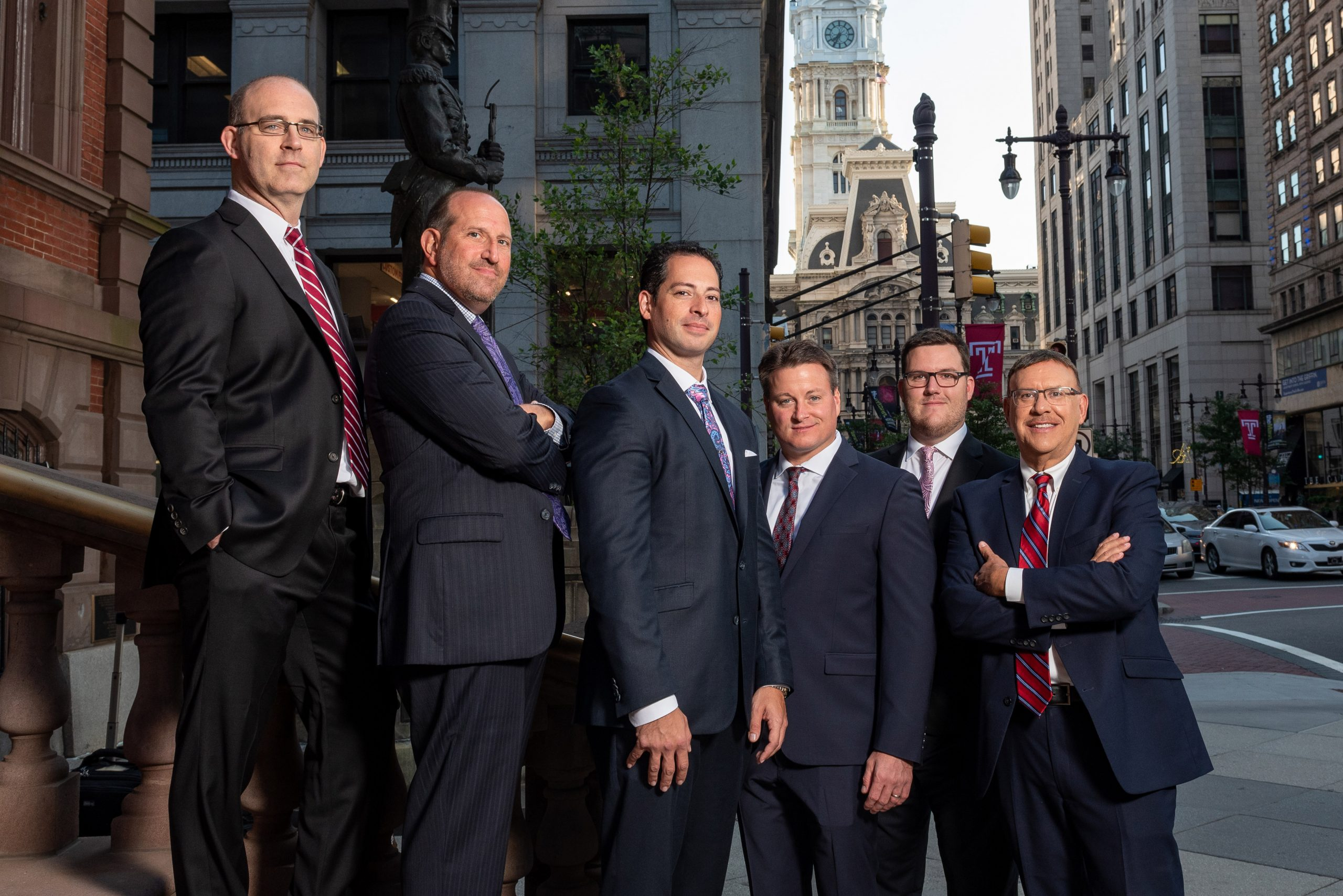 Spear Greenfield Personal Injury Attorneys legal team on outdoor steps in Philadelphia in front of City Hall