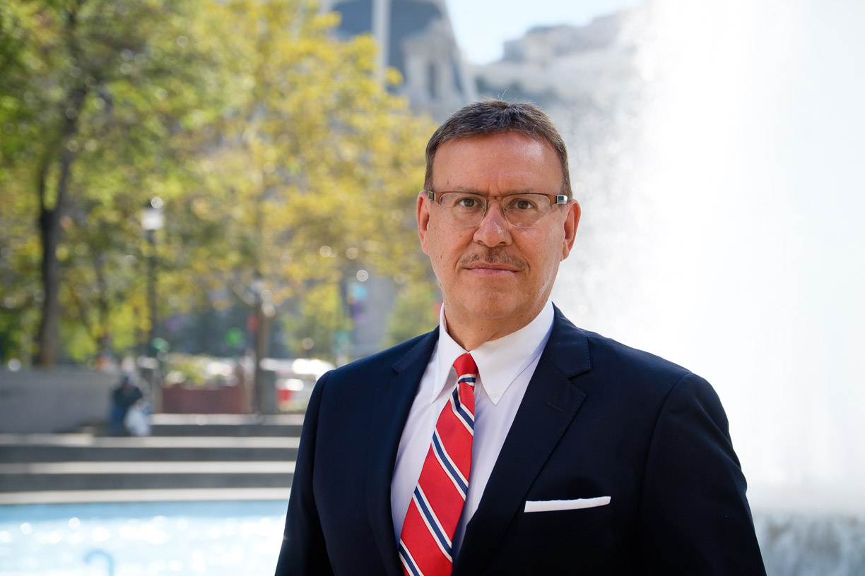 Portrait photo of Rand Spear Accident Attorney in front of fountain in front of Philadelphia City Hall
