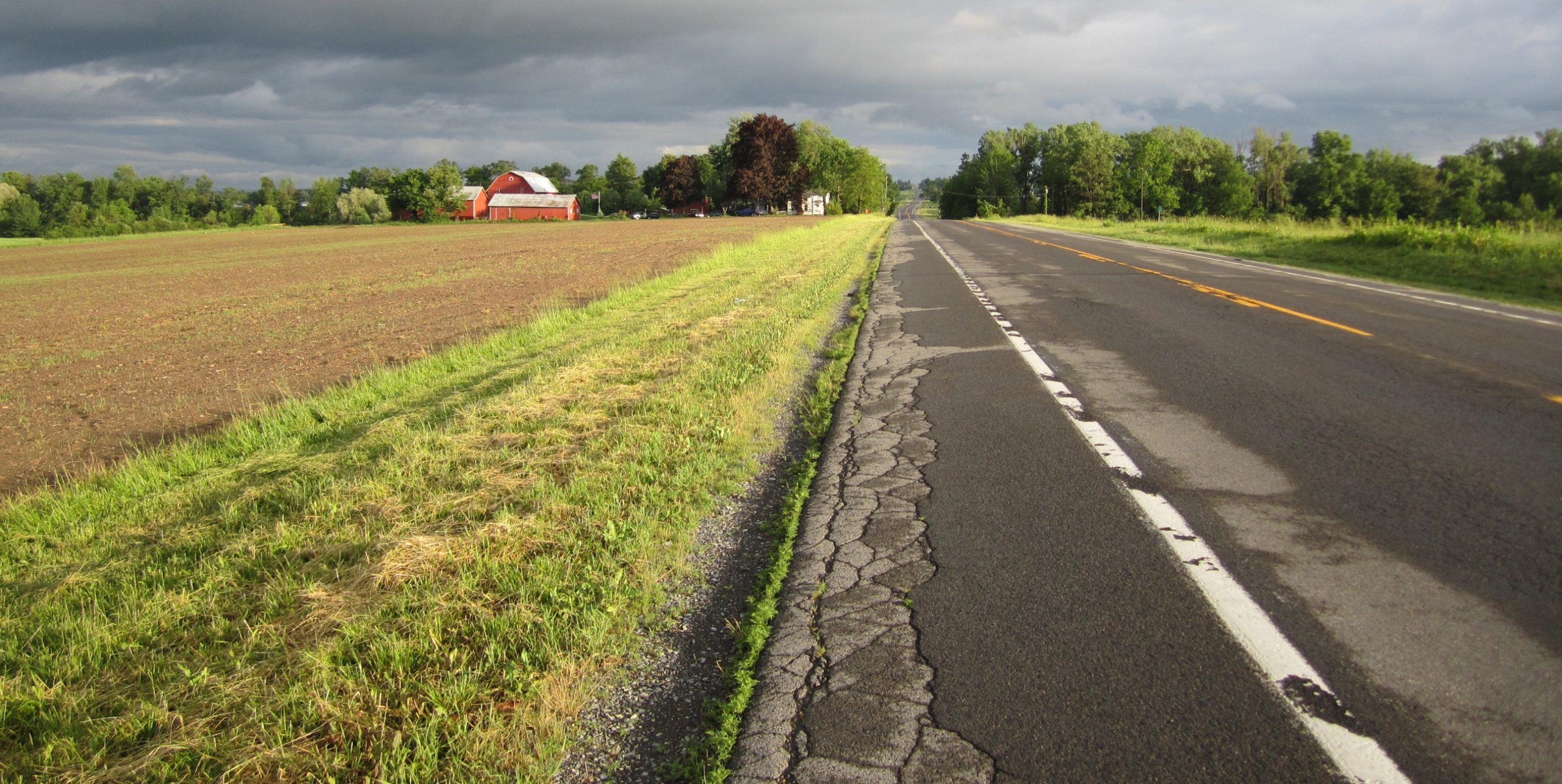 rural road with farm and fields