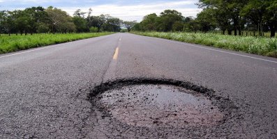 pothole in middle of rural road