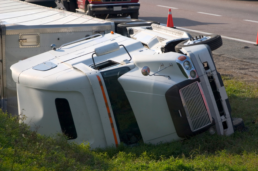 tractor trailer truck rolled over after auto accident