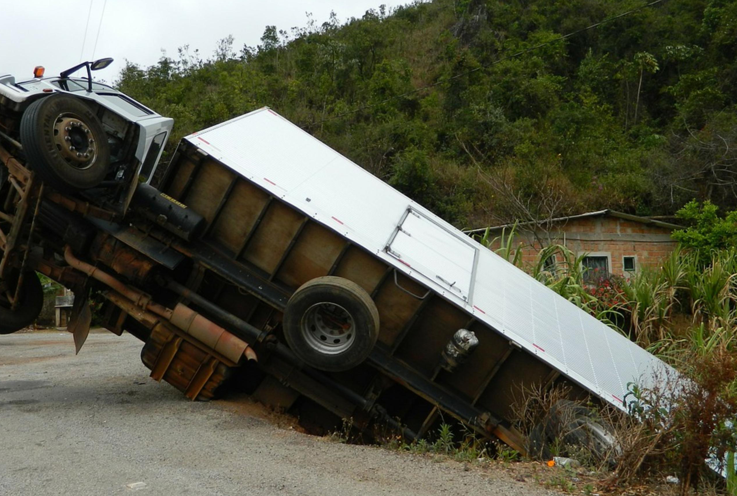 semi truck tipped over due to unsecured load