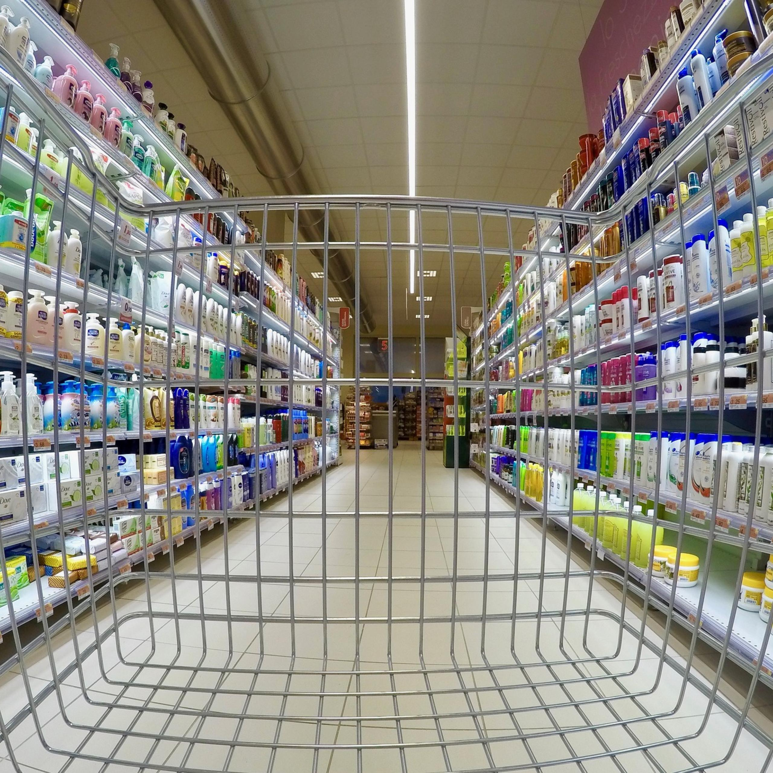 view of grocery store hair and body care aisle from shopping cart