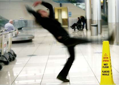 man slipping and falling on wet floor