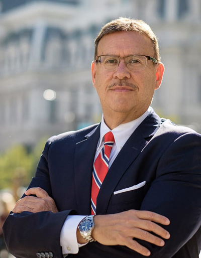 Portrait photo of Rand Spear Accident Attorney with arms crossed in front of Philadelphia City Hall