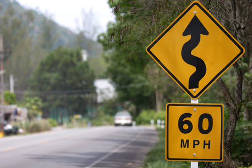 60 mph curved road sign