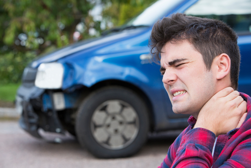 male with whiplash neck pain after car accident