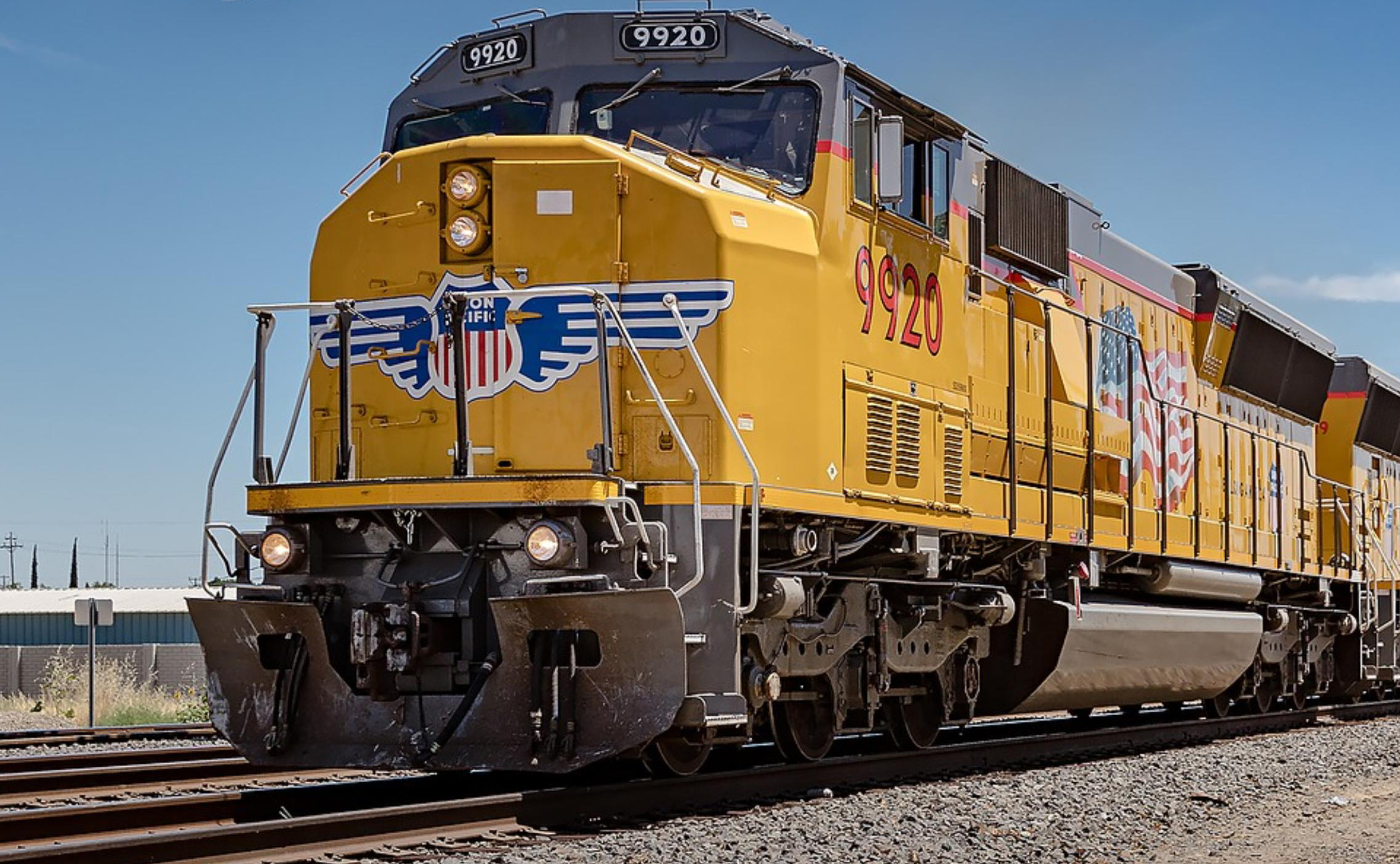 yellow Union Pacific freight train on tracks