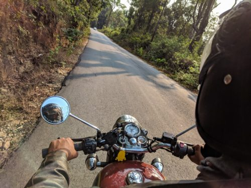 motorcycle driver's view of driving on rural road