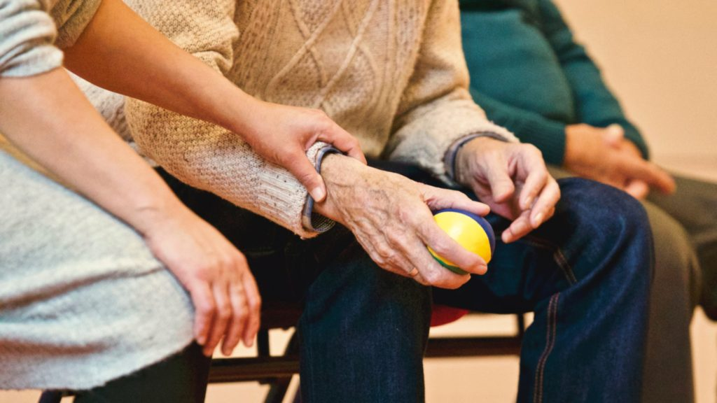 close up of elderly in therapy during adult care