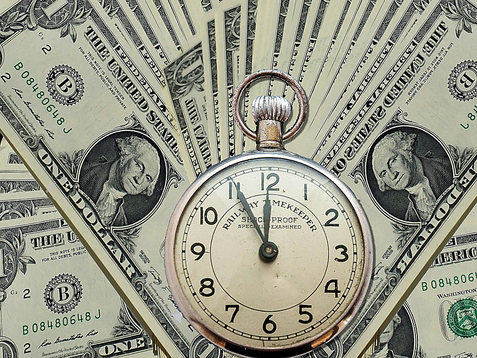 dollar bills and old time piece