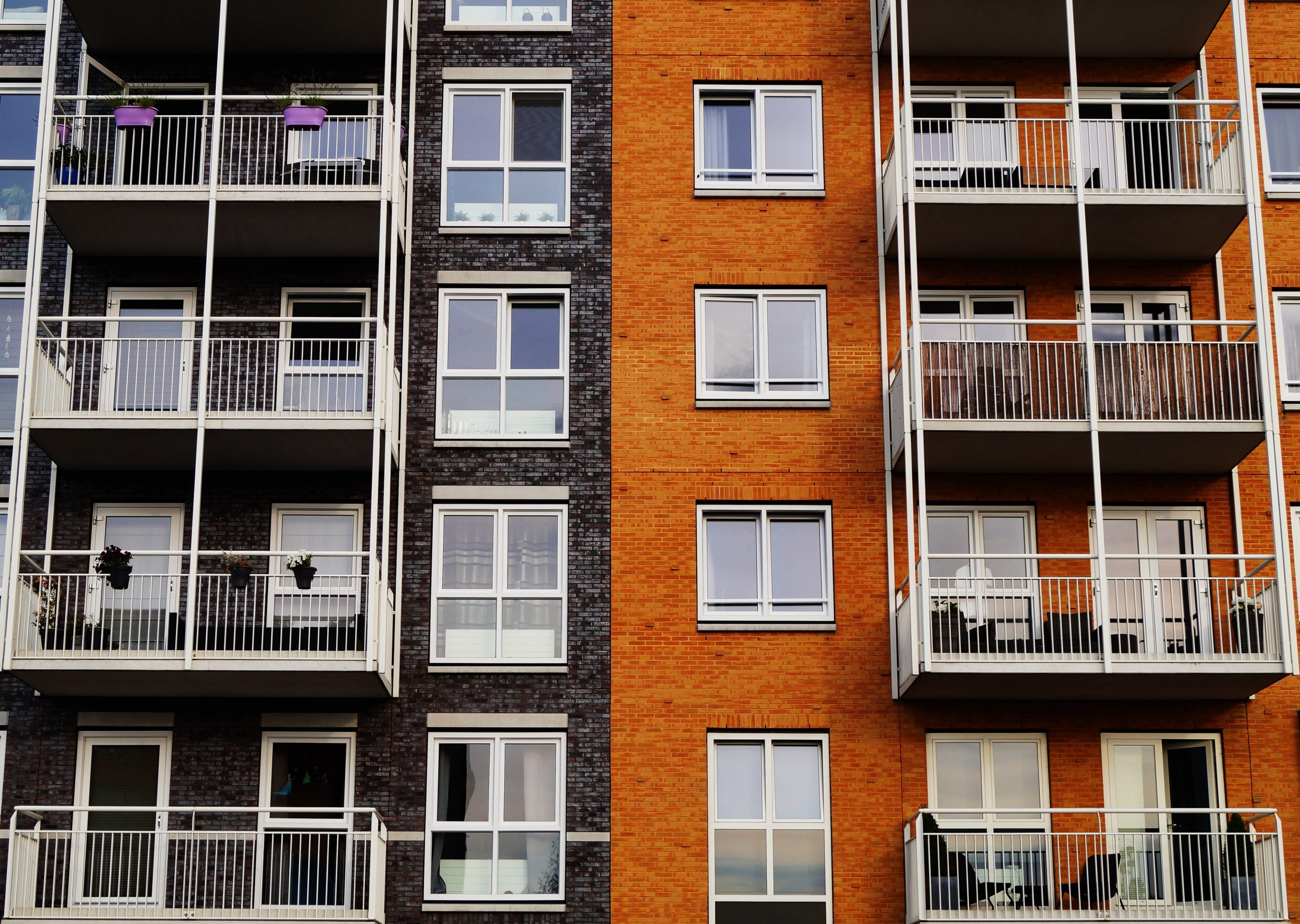 two toned apartment building with balconies