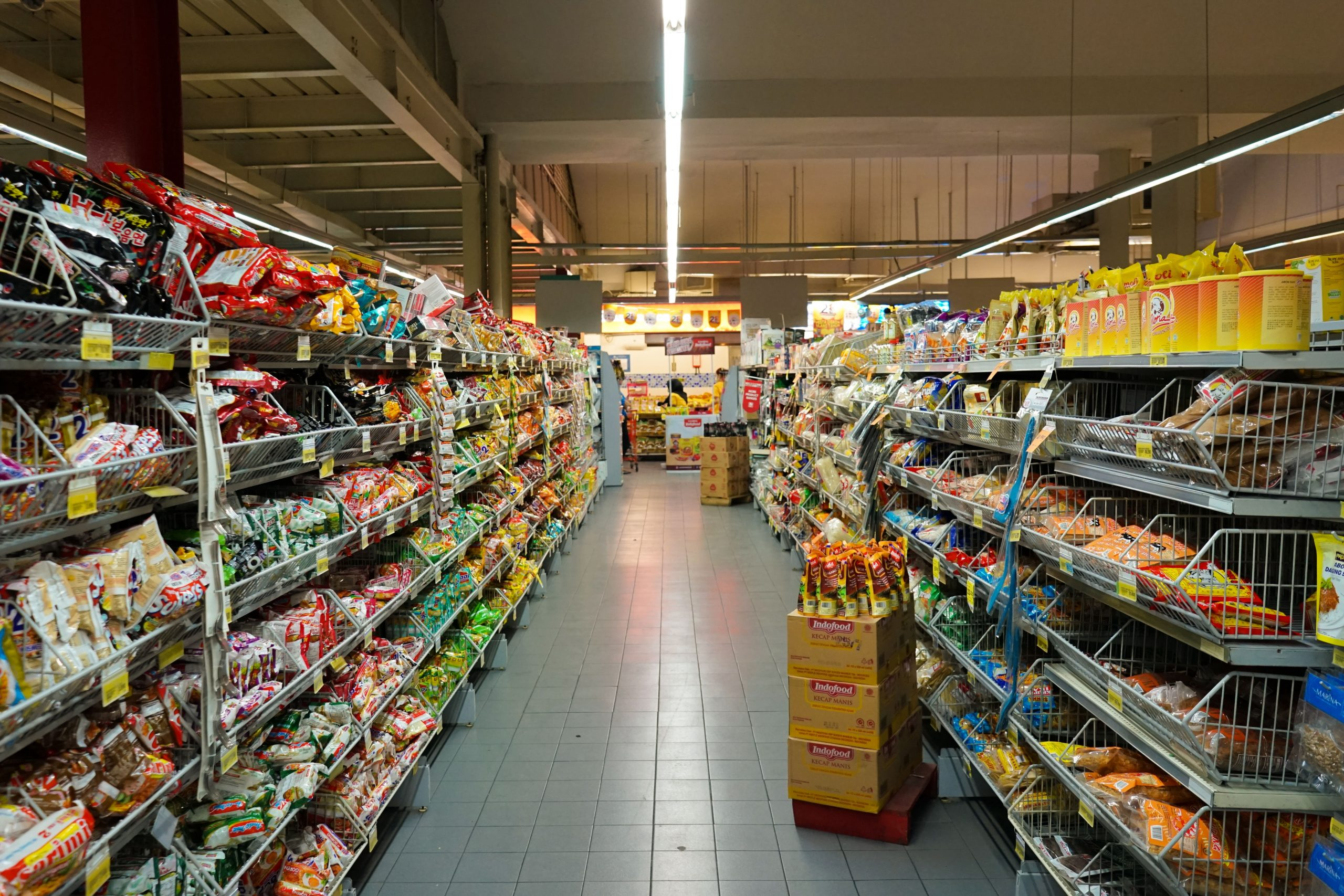 grocery store aisle with food in supermarket