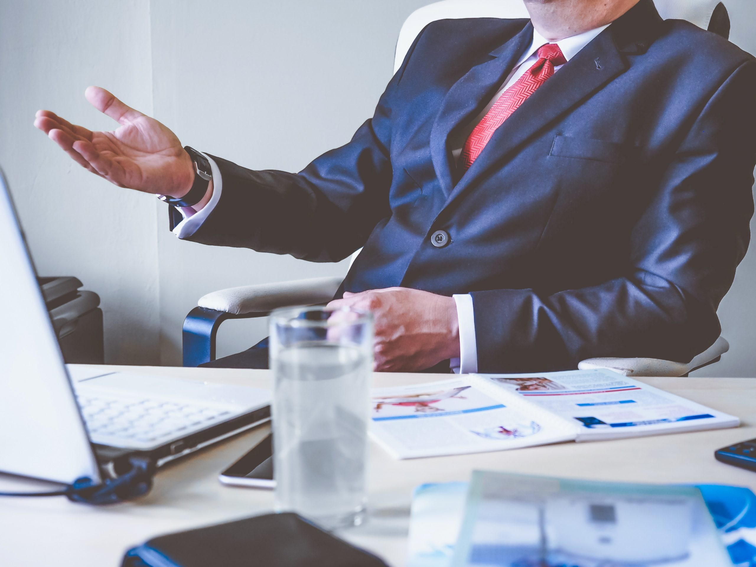 close up of man in business suit at office desk