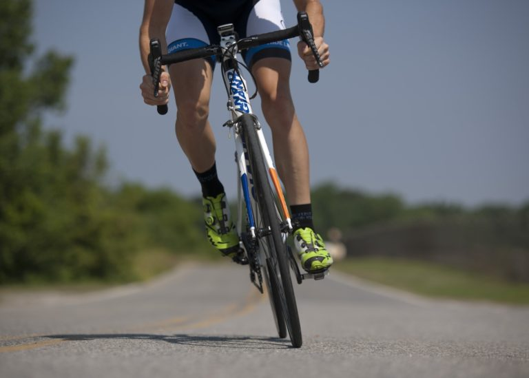 close up of cyclist cycling on bicycle