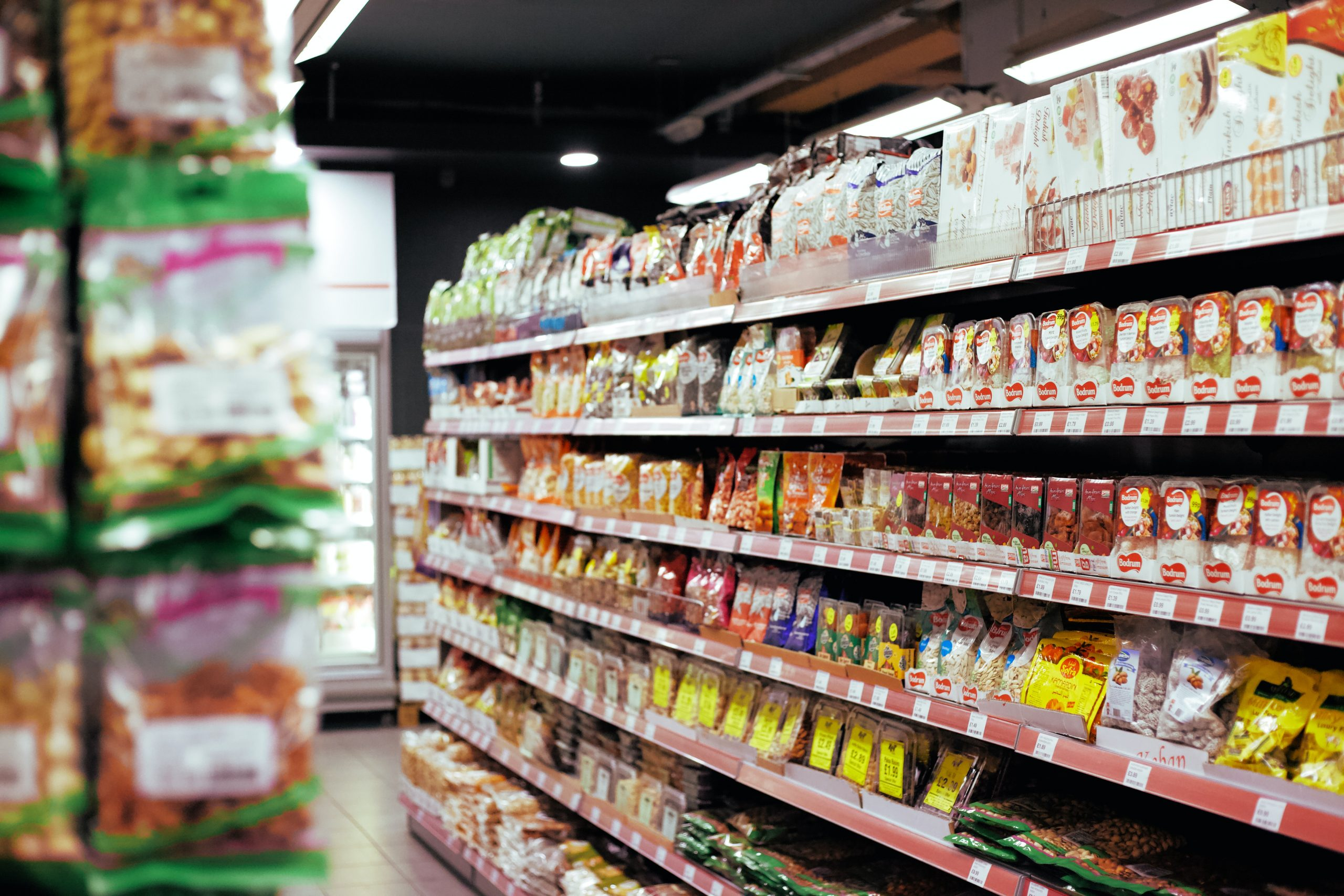close up of food shelves in supermarket aisle