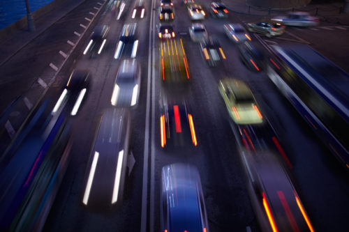blurred motion photo of driving on highway at night