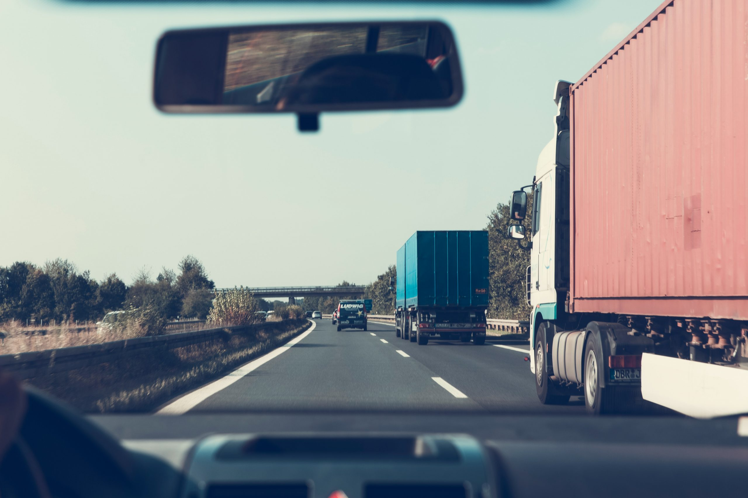 drivers view of driving on road with semi trucks