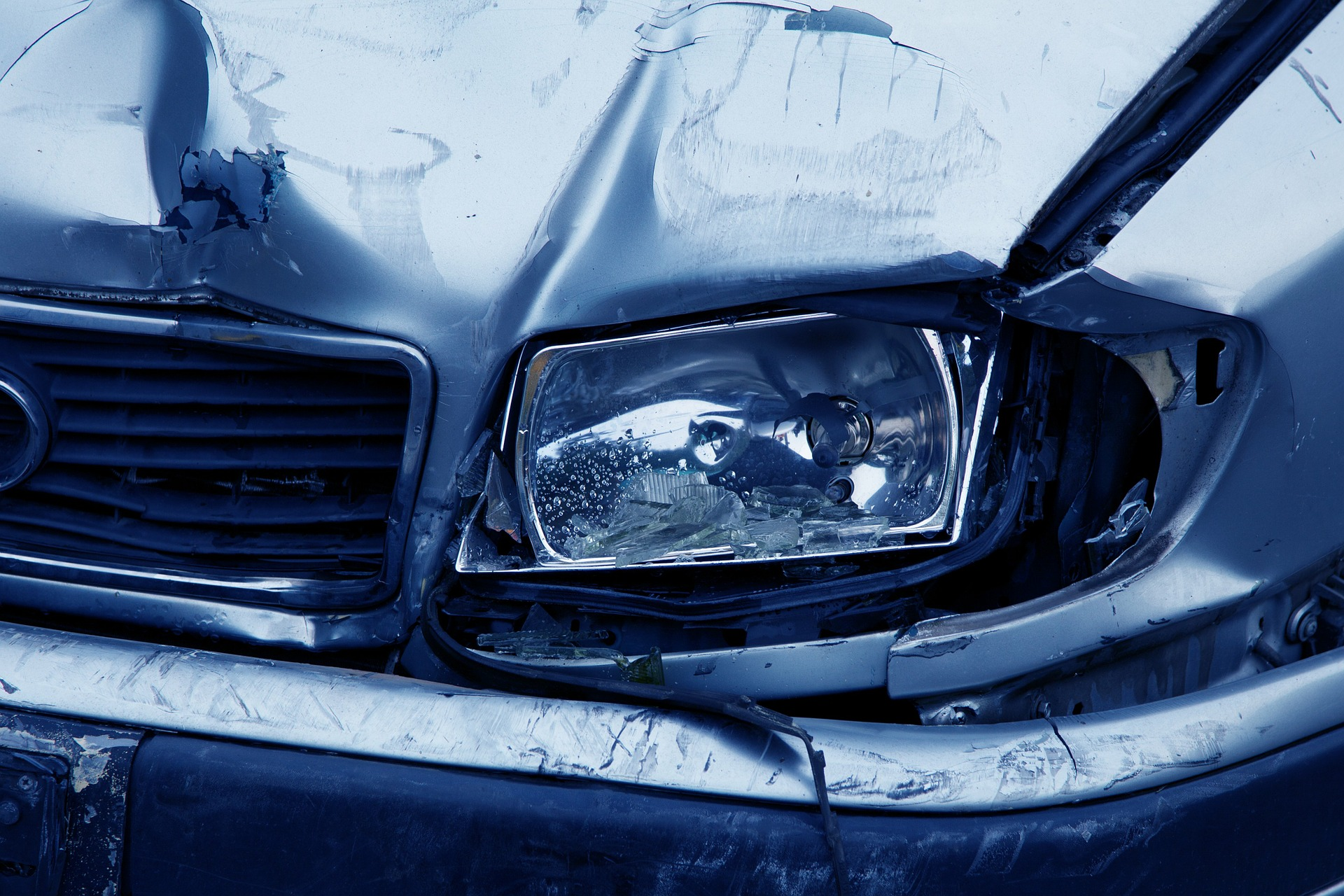 close up of car damage after auto accident