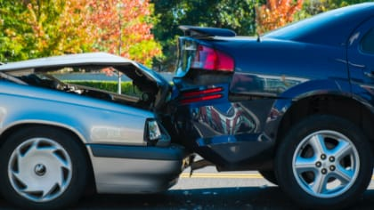 close up of car damage after rear end auto accident