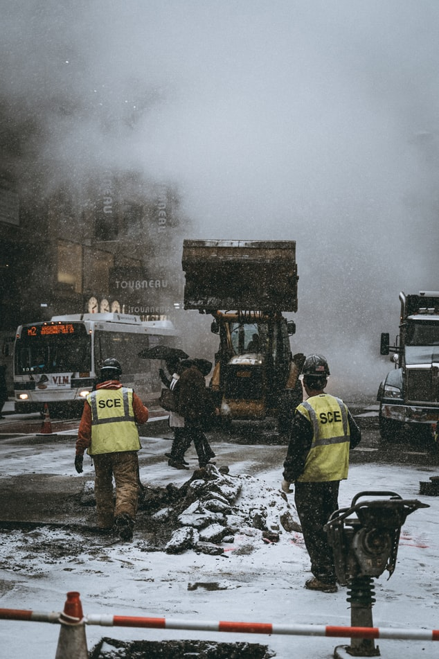 city clean up crew workers clearing snow and dirt in Philadelphia