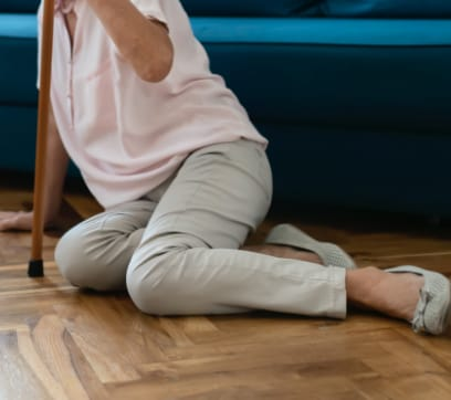 elderly woman on floor after slip and fall accident