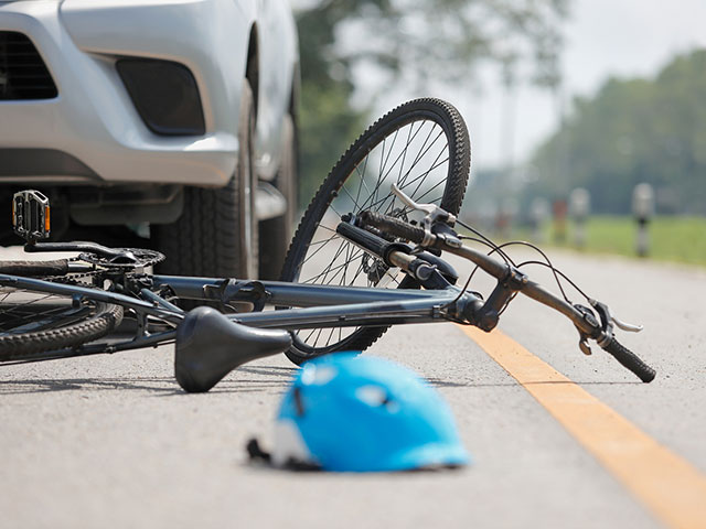 bicycle accident after being hit by car
