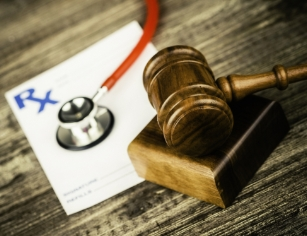 judges gavel with medical prescription and stethoscope