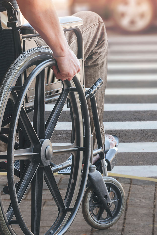 close up of man in wheelchair after serious injury accident