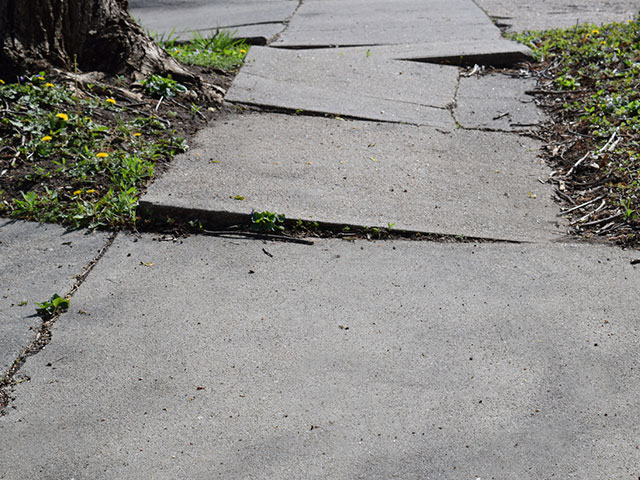 uneven and unsafe sidewalk that can cause accidents