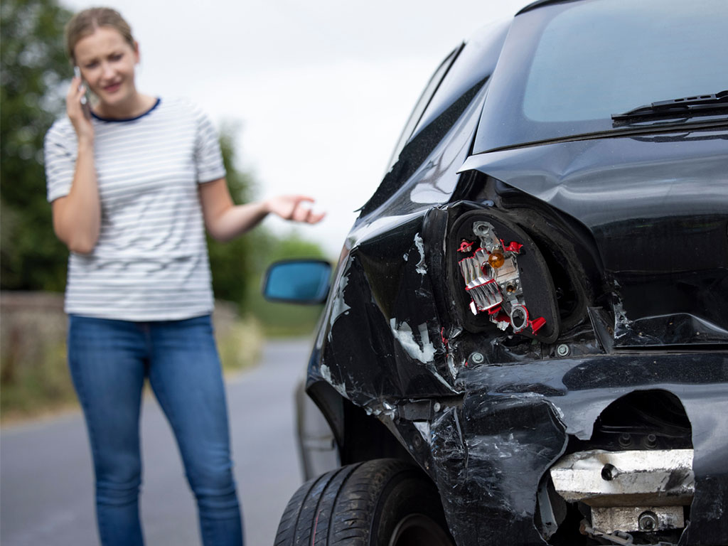 woman calling personal injury lawyer after car accident