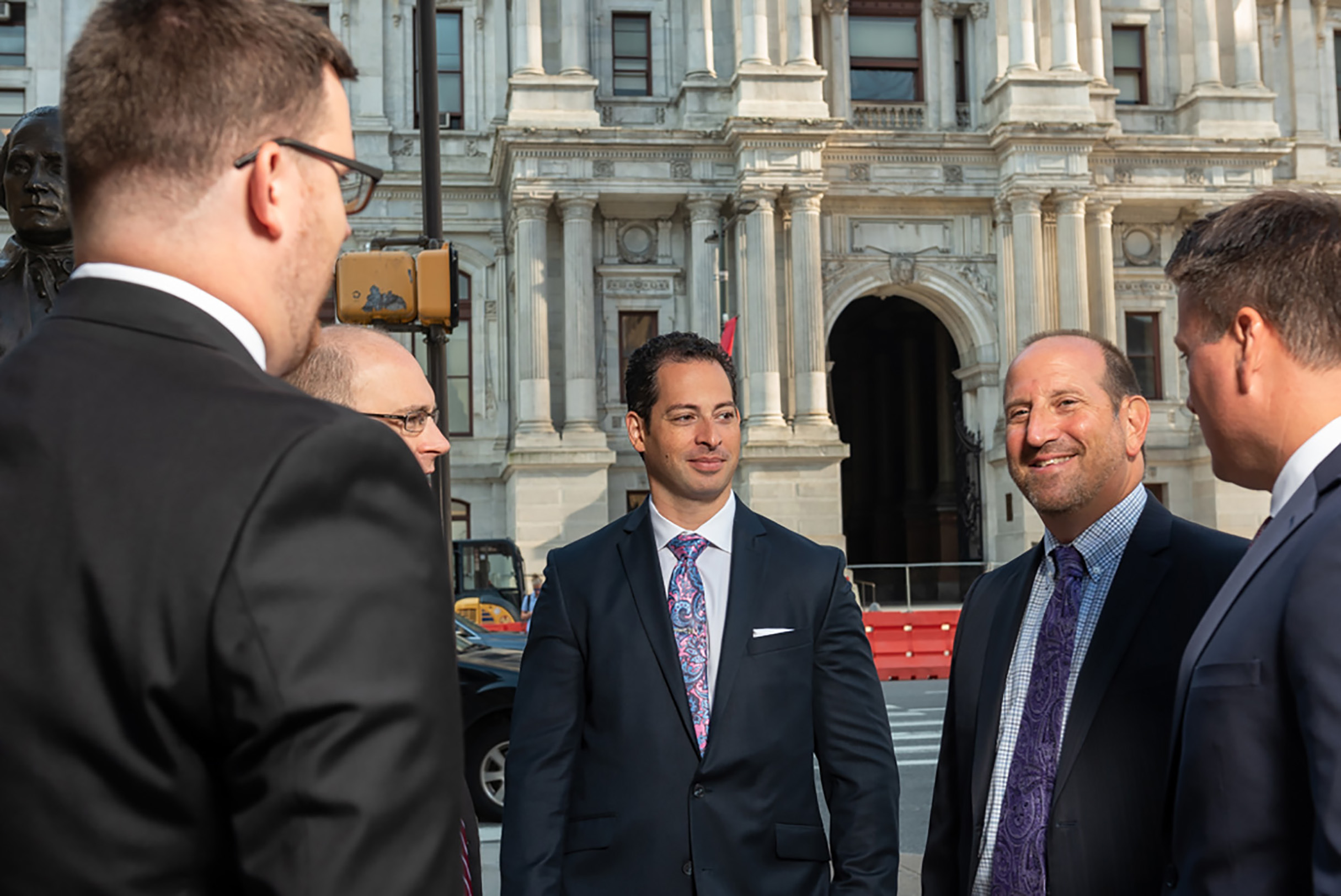 Spear greenfield attorneys talking in front of Philadelphia City Hall