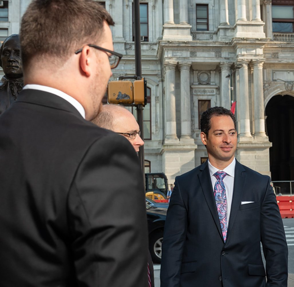 Side view of Spear Greenfield attorneys outside of Philly City Hall