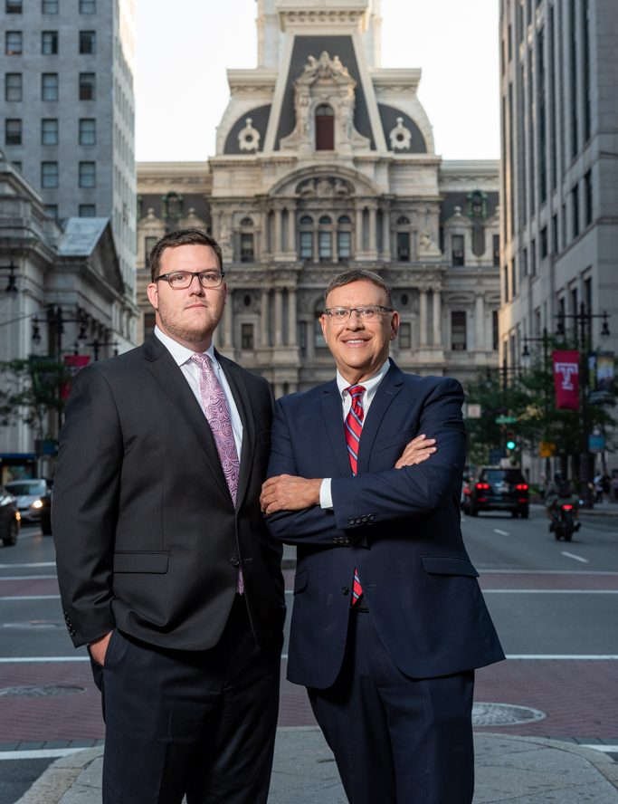 Personal Injury Attorneys Michael and Rand Spear in front of Philly City Hall