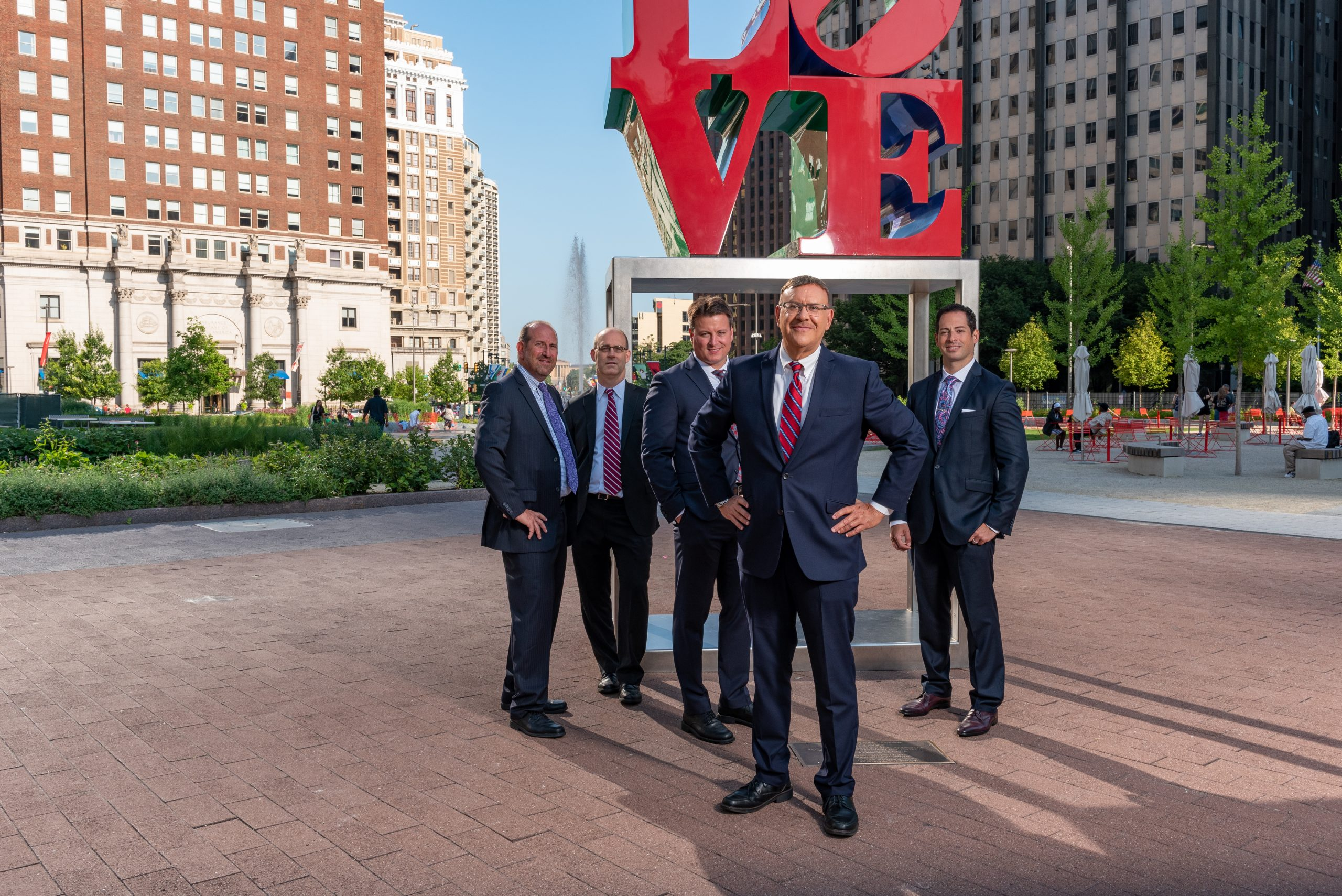 Spear Greenfield Personal Injury Attorneys legal team in front of Philadelphia Love Statue