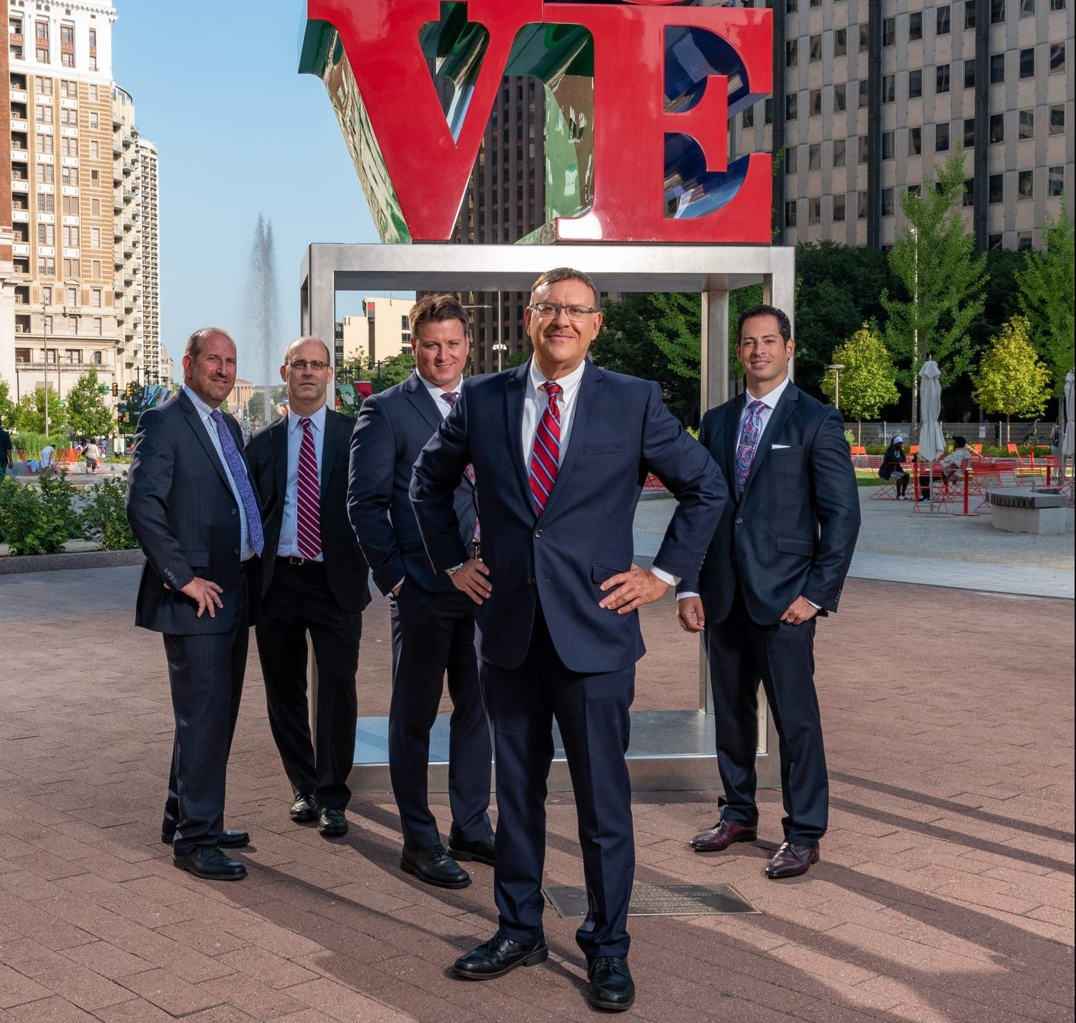 Spear Greenfield Personal Injury Attorneys legal team in front of Love Statue in Philly's Love Park