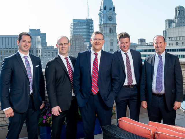 Spear Greenfield Personal Injury Attorneys legal team on rooftop in Philadelphia in front of City Hall
