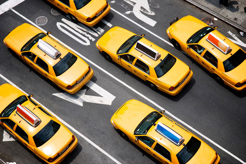 birds eye view of taxis driving in street
