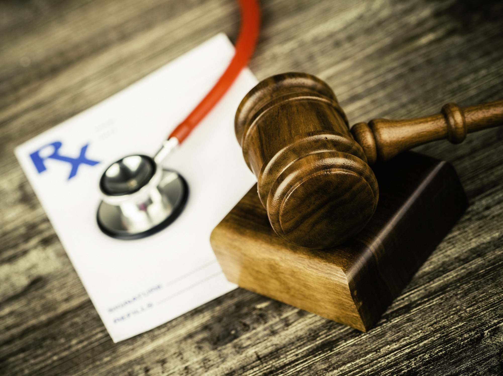 Prescription form with stethoscope and gavel. Medical Malpractice.