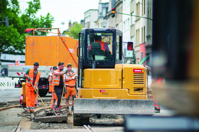 group of road construction workers working outside during the summer